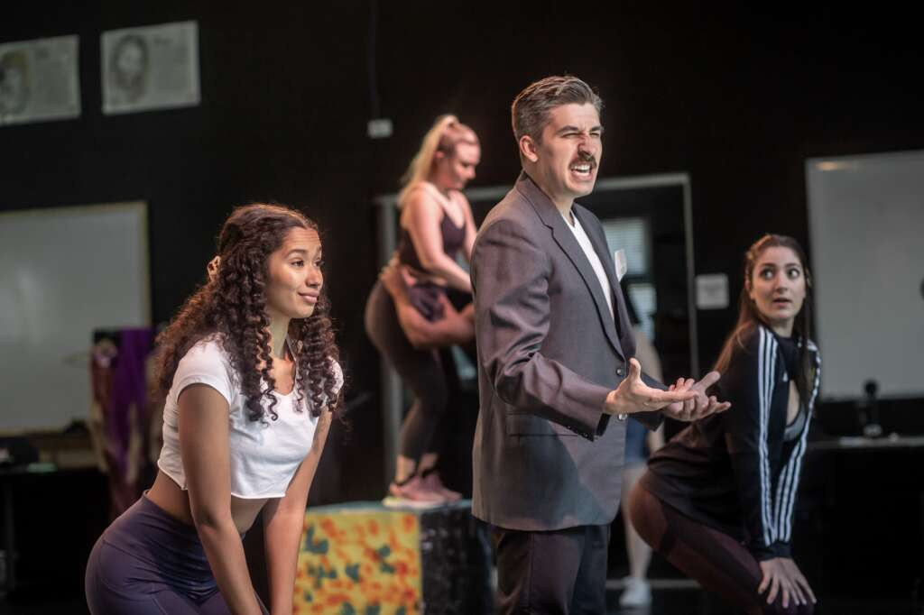 Nathan Cockroft (center, playing Billy Flynn) rehearses a song with the ensemble cast of Theatre Aspen's