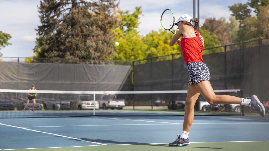 Park City High School's Reagan Harrison returns a volley during her third singles matchup against Provo High School's Sally Otterstrom at the Liberty Park tennis complex as part of the UHSAA 5A girls tennis championships Thursday morning, Oct. 7, 2021. (Tanzi Propst/Park Record)