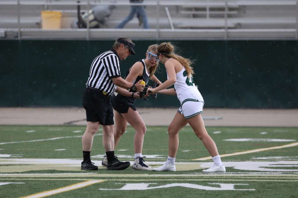 Summit High School sophomore Olivia Kerr takes the faceoff during the girls varsity lacrosse team's season opener vs. Battle Mountain on May 8 in Breckenridge. | Photo by Ashley Low / Ashley Low Photography