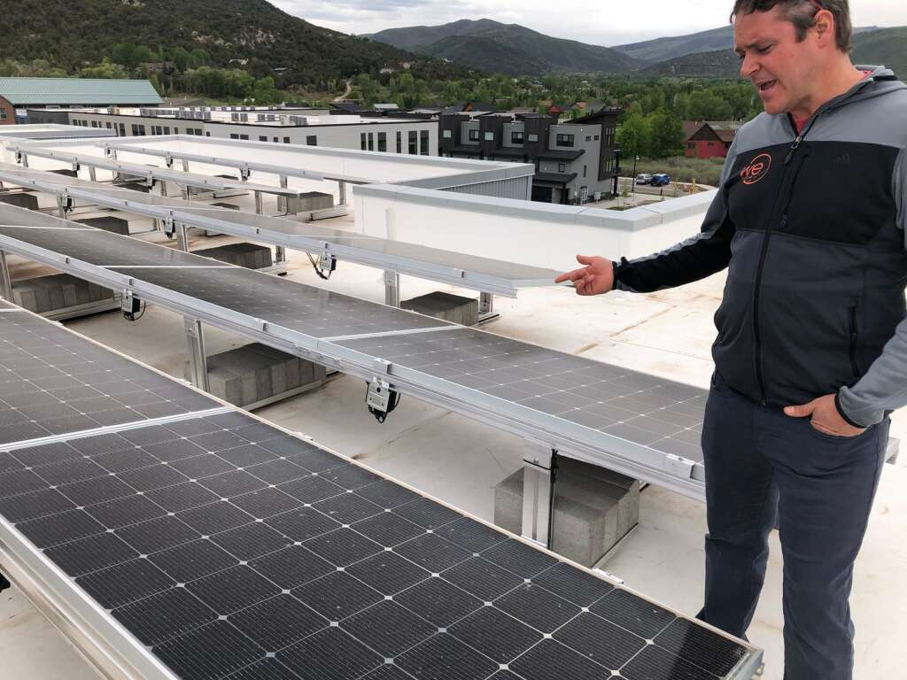 Philip Jeffreys, Skico's project manager on housing issues, points out the solar panels on the company's new affordable housing project. | Scott Condon/The Aspen Times