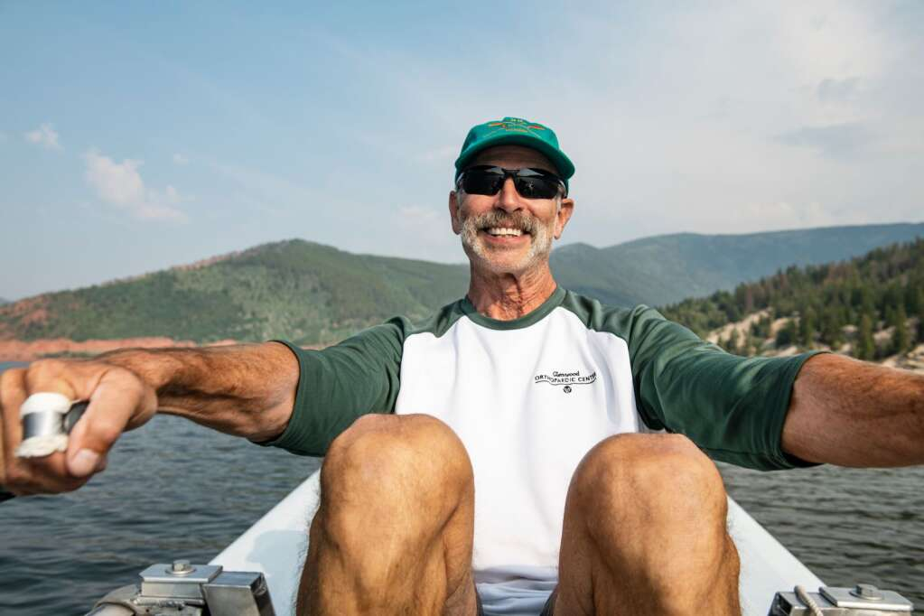 Jack Rafferty rows himself across Ruedi Reservoir on a warm morning with his fellow Ruedi Rowers Boat Club on Tuesday, July 13, 2021. (Kelsey Brunner/The Aspen Times)