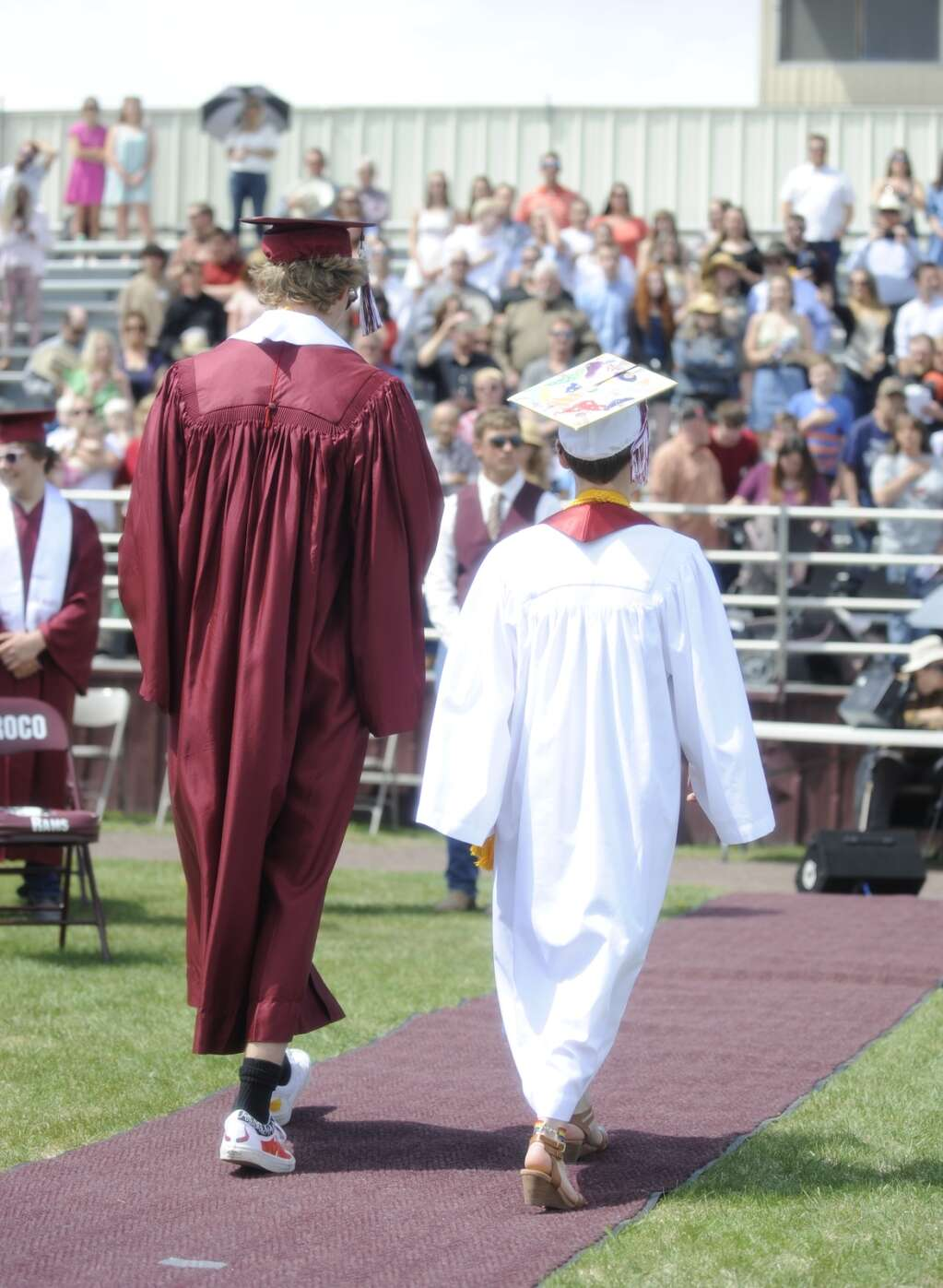 Class of 2021 members Liam Yaconiello and Sienna Russell walk to their seats during the Soroco High School graduation ceremony on Saturday morning.