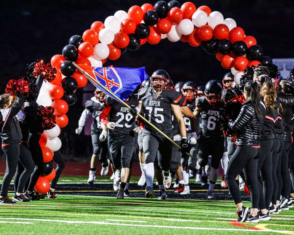 Aspen High School senior lineman Zach Small leads the team onto the field prior to its homecoming football game against Delta on Friday, Oct. 8, 2021, on the AHS turf. The Panthers won, 56-0. Photo by Austin Colbert/The Aspen Times.