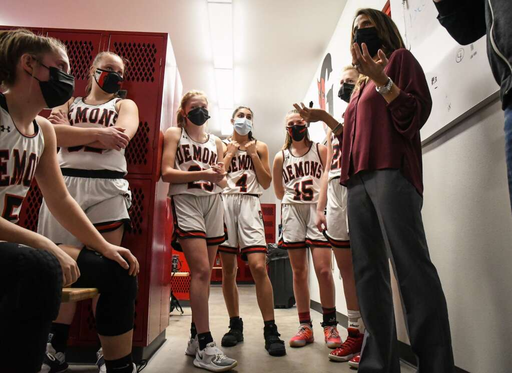 Glenwood Springs Demons head coach Rhonda Moser speaks to her players in the locke rroom during halftime of Tuesday night's rivalry game against the Rifle Bears. |Chelsea Self / Post Independent