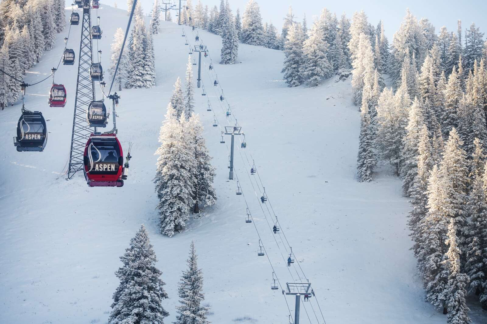 Skiers utilize both the Silver Queen Gondola and Bell Mountain Lift on opening day at Aspen Mountain on Wednesday, Nov. 25, 2020. (Kelsey Brunner/The Aspen Times)