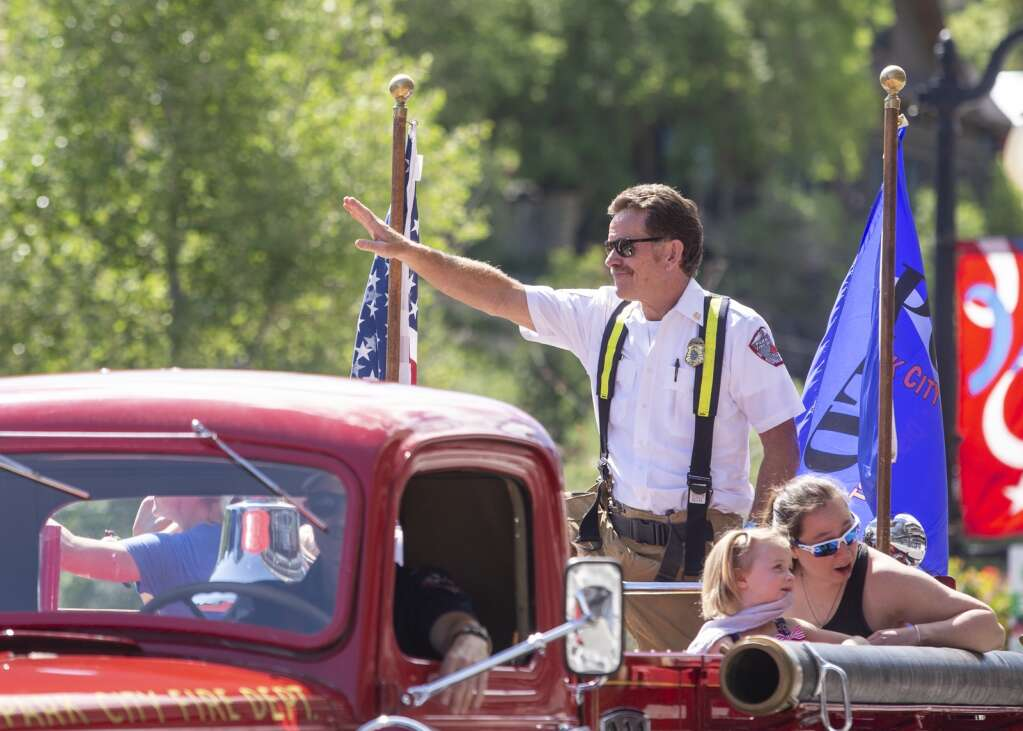Park City Fire Department Chief Paul Hewitt waves to spectators of the Independence Day parade on Main Street Friday morning, July 2, 2021. (Tanzi Propst/Park Record)