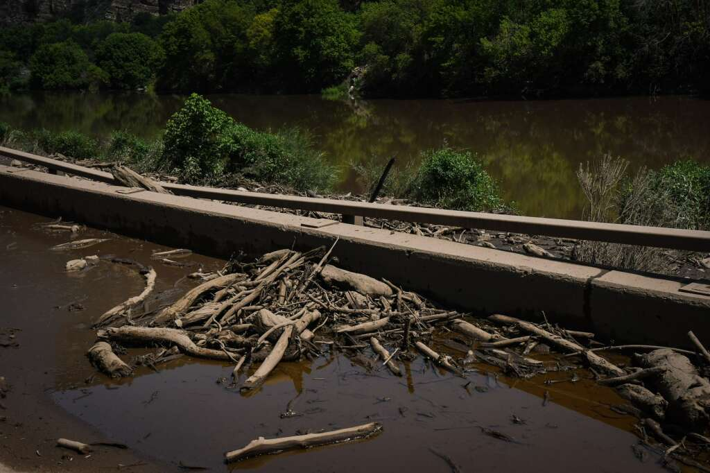 Water, mud and debris sit on the eastbound deck of Glenwood Canyon near Bair Ranch MM 129.  |Chelsea Self / Post Independent