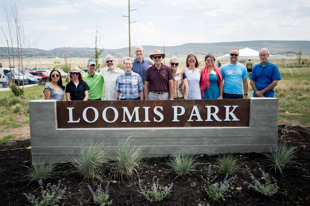 """Officials gathered Friday to celebrate Scott Loomis, a man they credited with creating more than 600 affordable housing units in his 20 years at the helm of the nonprofit Mountainlands Community Housing Trust.Standing in Silver Creek Village, the future site of 1,300 homes and hundreds of affordable housing units, 64 of which Mountainlands has already built, officials revealed the name of a neighborhood gathering space, """"Loomis Park.""""  Bob Richer, a former Summit County Commissioner, called Loomis one of Summit County's """"civic heroes,"""" and credited him with using nearly $100 million in state and federal funding to help the local housing situation.""""What I always admired was he, rather than all the good people who talk about affordable housing, he was actually putting keys in doors and building homes,"""" Richer said. 