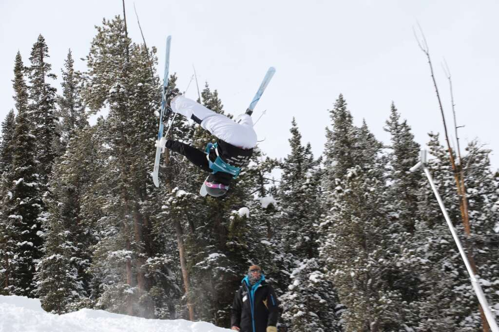Team Summit mogul skier Evelyn Harris inverts while riding through the bumps. | Photo from Evelyn Harris