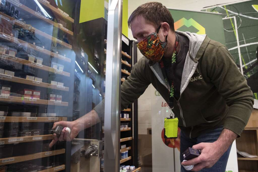 Nick Donovan, a manager at Altitude Organic Cannabis in Dillon, wears a protective mask while collecting cannabis products Tuesday, Feb. 16. | Photo by Jason Connolly / Jason Connolly Photography