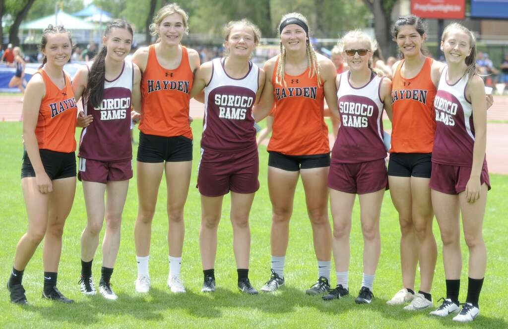 From left, Mia Mikos, Marissa Martindale, Jillian Bennett, Lexi Vandenberg, Alison Rajzer, Larhae Whaley, Isabella Simones and Kayedence Bruner make up the Soroco and Hayden 800 medley relay teams. Both squads were busy with multiple relays at the CHSAA Track and Field State Championships at JeffCo Stadium on Friday. (Photo by Shelby Reardon)