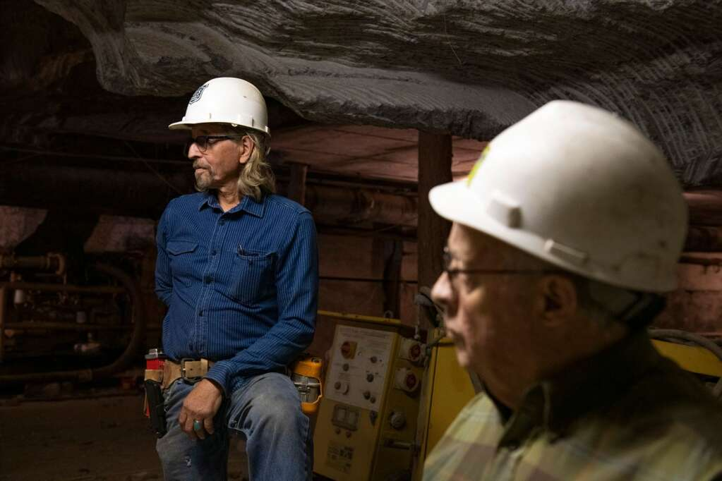 Robert Congdon and Walt Brown discuss the history of the White Banks Alabaster Mine outside of Redstone on Thursday, July 29, 2021. (Kelsey Brunner/The Aspen Times)