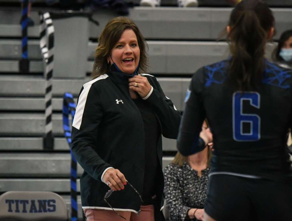 Coal Ridge Volleyball Coach Aimee Gerber speaks with a player during last week's game against Rifle. |Chelsea Self / Post Independent