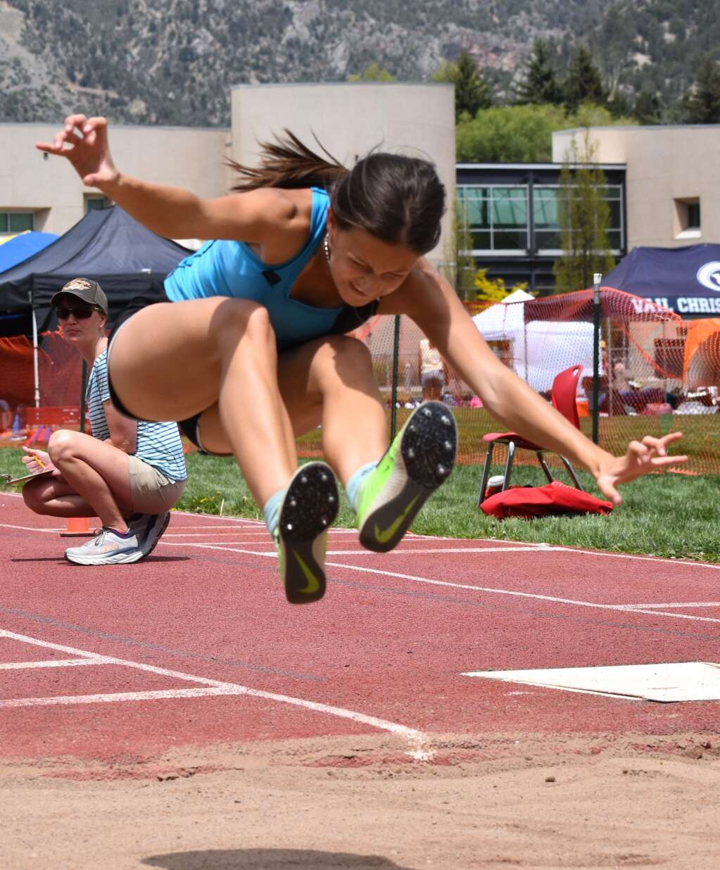 A Coal Ridge High School triple jumper competes in the Demon Invitational on Saturday.|  John Stroud/Post Independent