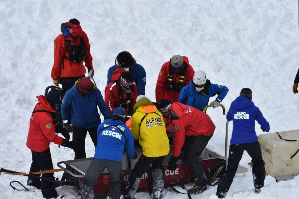 Rescue workers transfer the buried person to the snowmobile for evacuation. | Photo by Sawyer D'Argonne / sdargonne@summitdaily.com