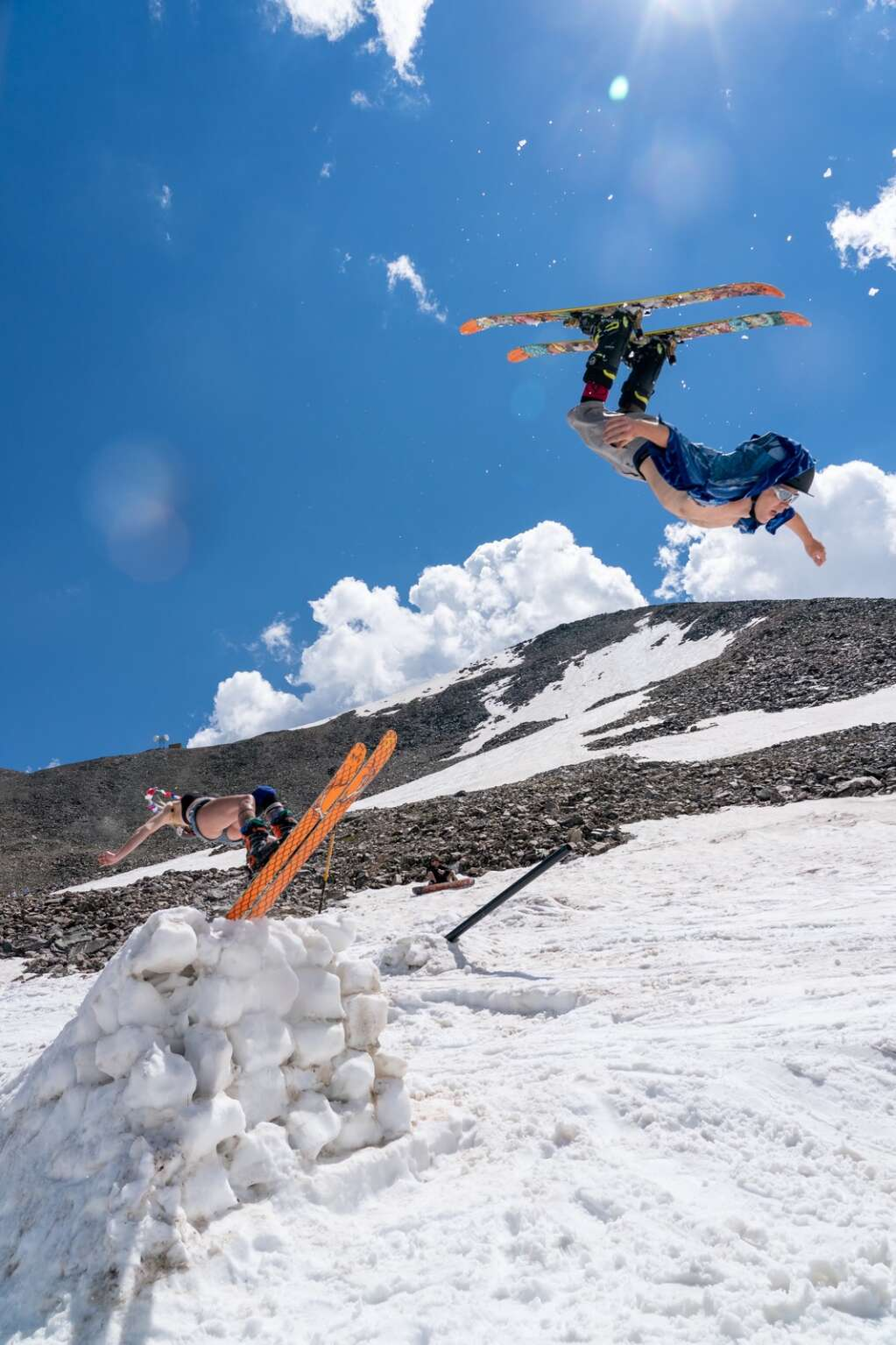 Skiers send backflips off the money booter at Fourth of July Bowl on Peak 10 at Sunday's fourth annual Peak 10 Classic. | Photo by Sage Vogt