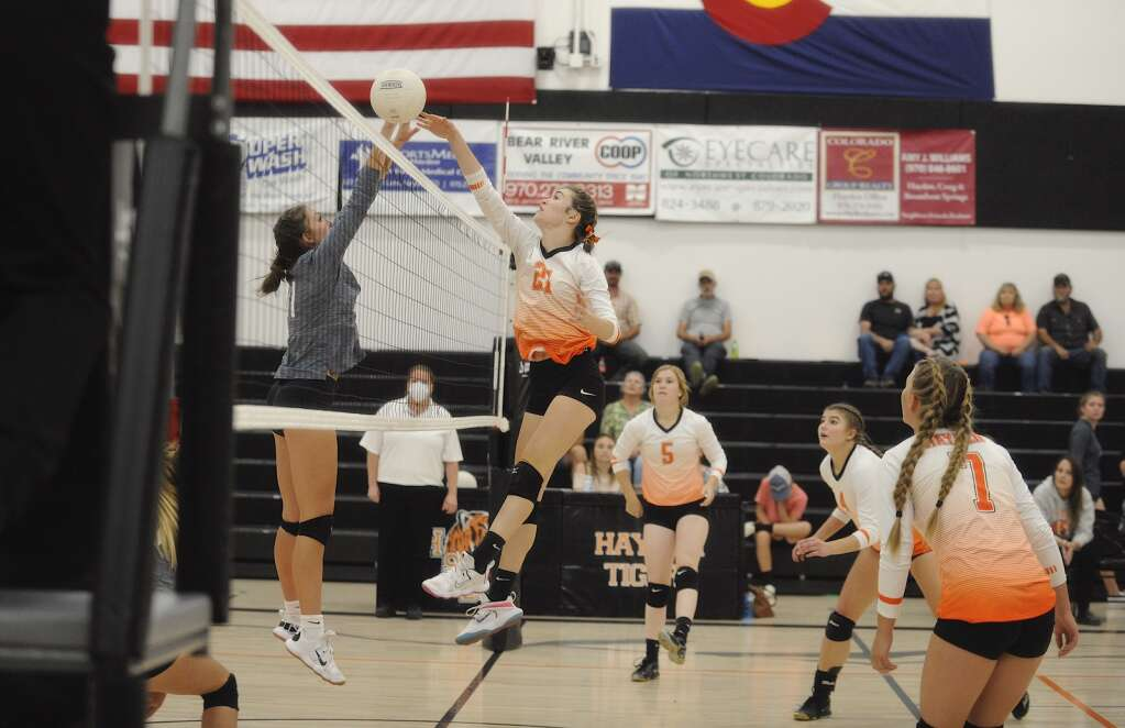 Hayden volleyball senior Jillian Bennet wins a battle for the ball at the net during a home game against Vail Mountain on Friday night. | Shelby Reardon/Steamboat Pilot & Today