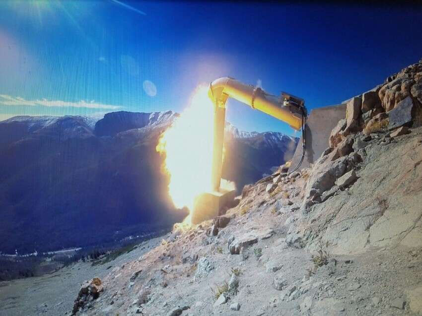 An explosion is triggered from a Gazex remote avalanche control system. | Photo from Colorado Department of Transportation