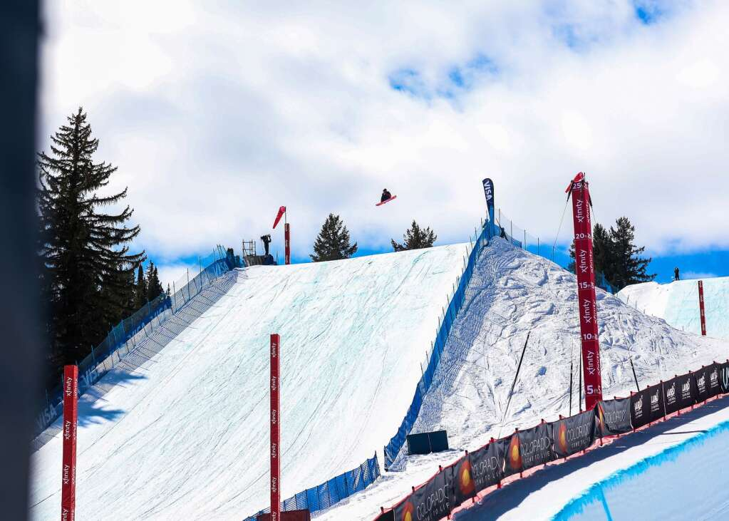 A rider competes in the men's snowboard slopestyle qualifier of the Land Rover U.S. Grand Prix and World Cup on Friday, March 19, 2021, at Buttermilk Ski Area in Aspen. Photo by Austin Colbert/The Aspen Times.