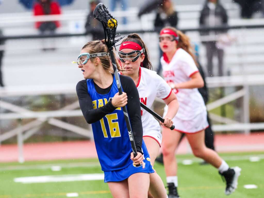 Roaring Fork's Libby Claassen brings the ball upfield against Aspen on Monday, May 17, 2021, on the AHS turf. Photo by Austin Colbert/The Aspen Times.
