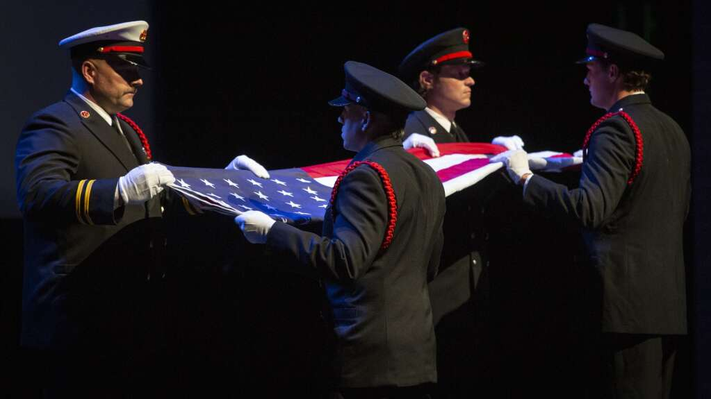 Firefighters folded the American flag before presenting it to Kelly Trang, Hewitt's fiancée. The display was one of the most poignant of the night, occurring during several minutes of silence. | (Tanzi Propst/Park Record)