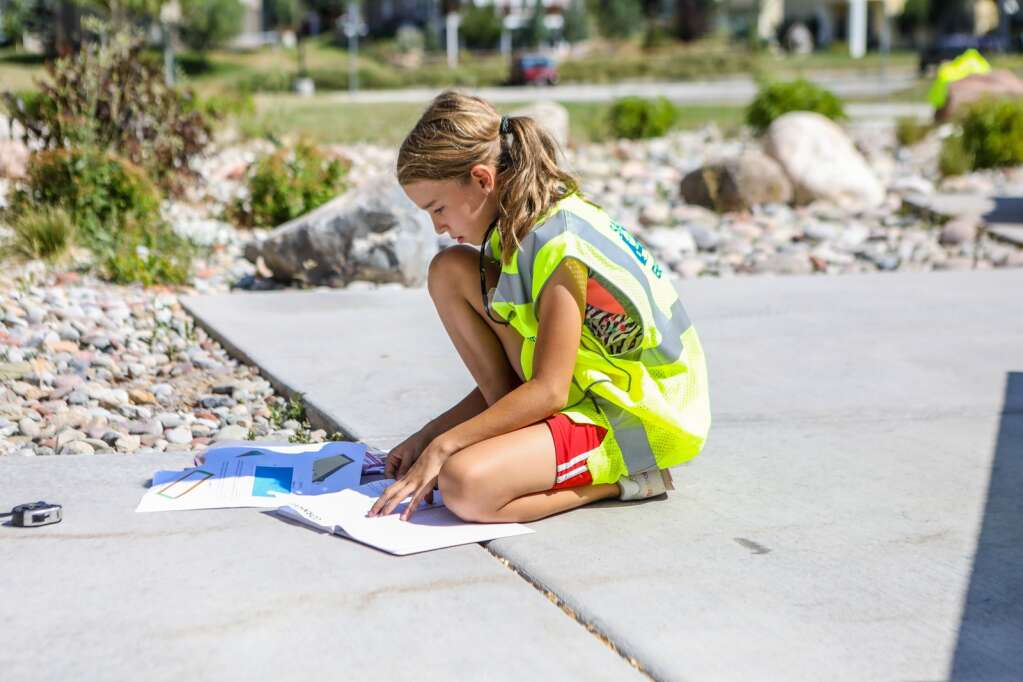 Kalina Ivanov reviews the plans on how to construct a cornhole board during YouthPower365's Pathfinders Camp build day Friday at Eagle Valley Elementary School in Eagle.  | Chris Dillmann/cdillmann@vaildaily.com