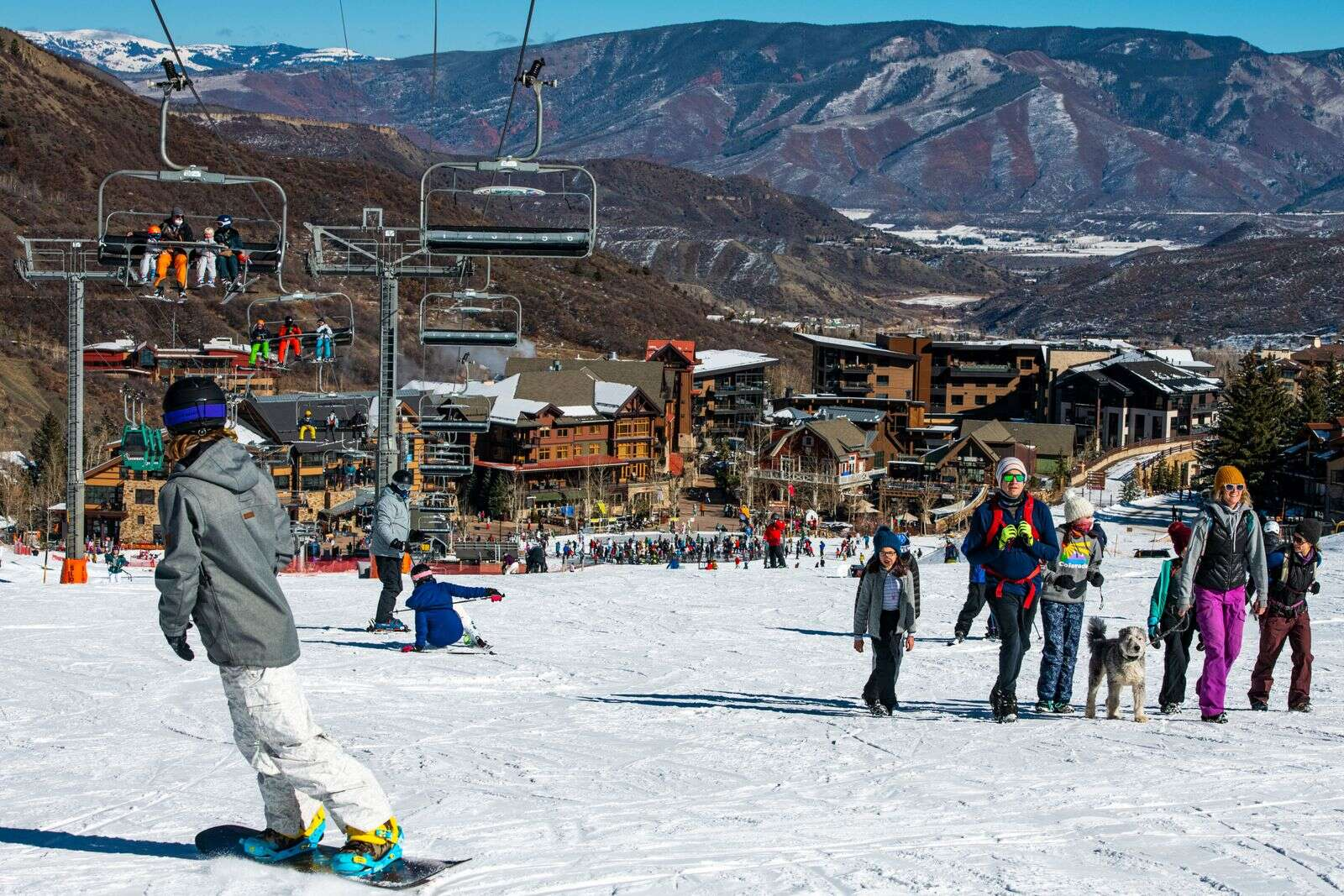 Crowds of people utilize the open ski runs on Snowmass on Friday, Nov. 27, 2020.