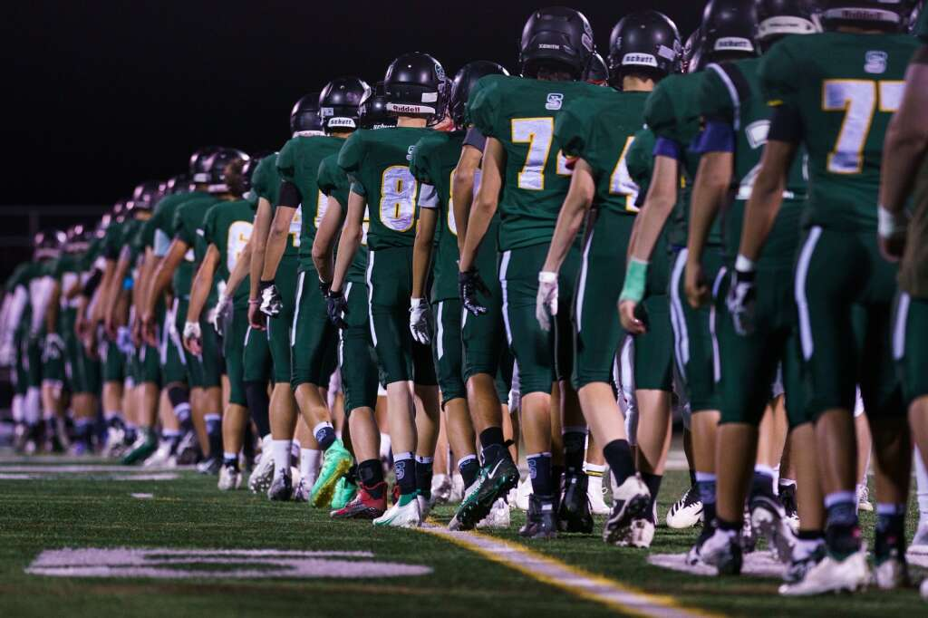 Players line up for the postgame handshake Friday, Sept. 10, at Tiger Stadium in Breckenridge. | John Hanson/For the Summit Daily News