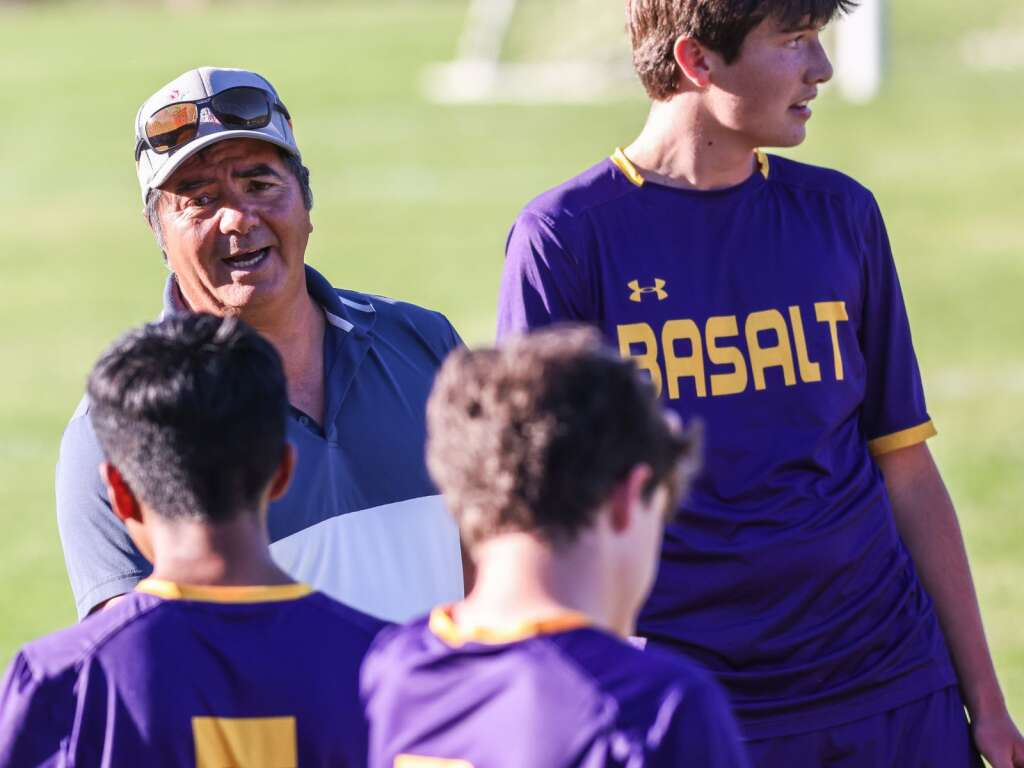 Basalt High School boys soccer coach Carlos Salazar talks to the players during their game against Aspen on Wednesday, Sept. 15, 2021, on the BHS field. | Photo by Austin Colbert/The Aspen Times