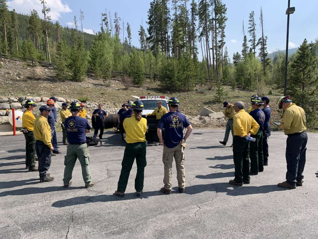 The Summit Fire & EMS and Red, White & Blue Fire Protection District met for a debriefing following a wildland fire training exercise Tuesday, June 8, near County Commons. | Photo by Sawyer D'Argonne / sdargonne@summitdaily.com