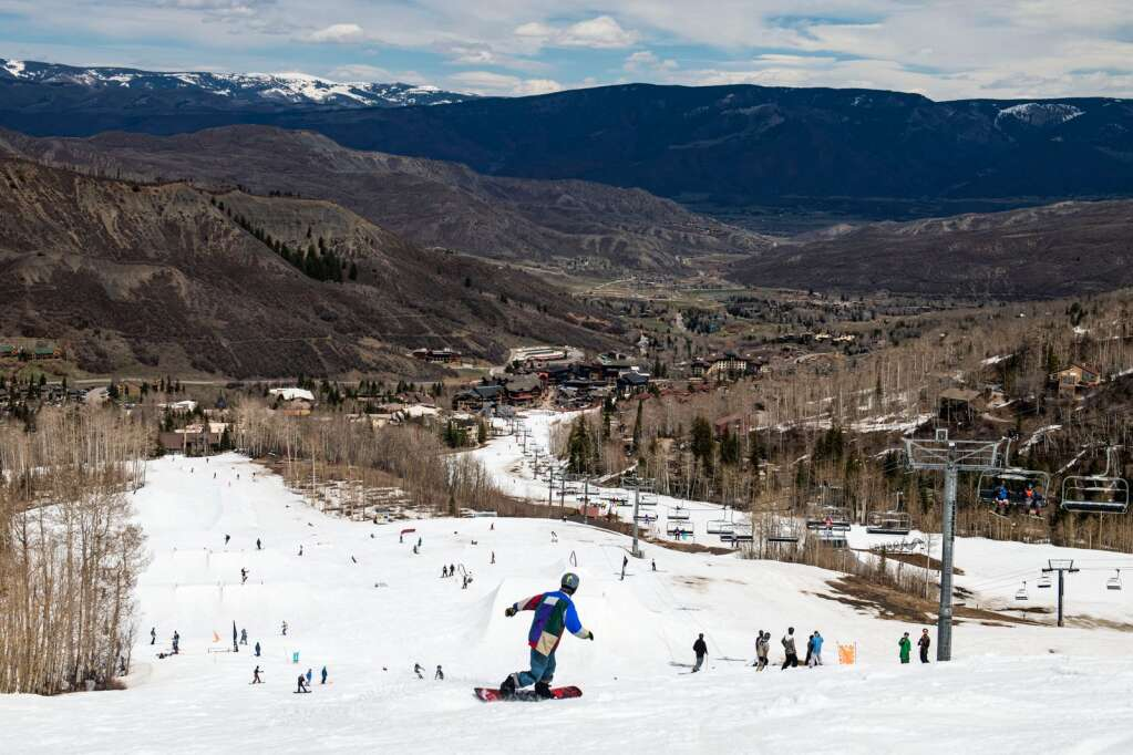 On the final day of the Aspen Snowmass ski season, locals and visitors enjoy the warm spring weather by dressing up and skiing slush in Snowmass on Sunday, April 25, 2021. (Kelsey Brunner/The Aspen Times)