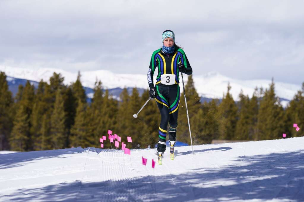 Maclean Donovan of Summit High crests a hill as she heads out on her first of two laps around the course during the CHSSL Ski Race held at the Colorado Mountain College, Leadville campus. | Photo by John Hanson
