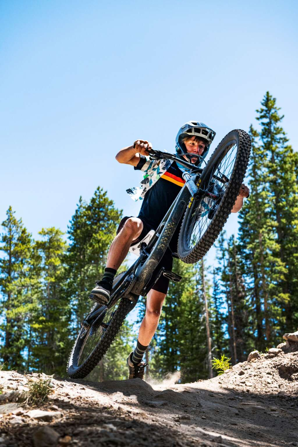 Peter Cull, 16, pops a wheelie on a jump on Valhalla while riding in the Snowmass Downhill Bike Park on Tuesday, June 30, 2020. Cull is from Denver and has been mountain biking for at least 6 years.  (Kelsey Brunner/The Aspen Times)