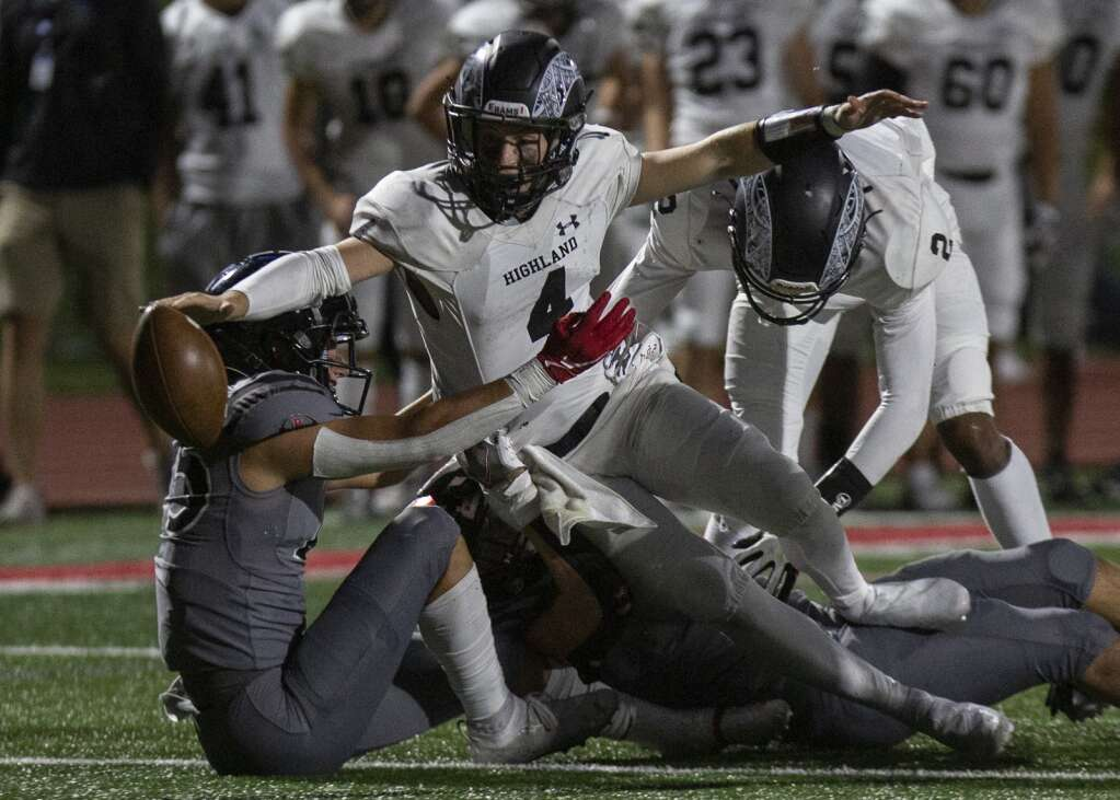 Highland High School's Ashton Zwick (4) loses control of the ball as he's tackled by Park City High School defense, fumbling near the end zone, during the game at Dozier Field Friday evening, Sept. 17, 2021. The Rams fell to the Miners 41-6. (Tanzi Propst/Park Record)