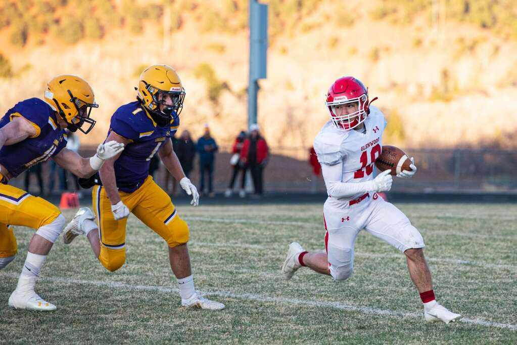 Glenwood Springs High School's Ray Rosenmarkel runs the ball during the game at Basalt High School on Friday, April 9, 2021. (Kelsey Brunner/The Aspen Times)