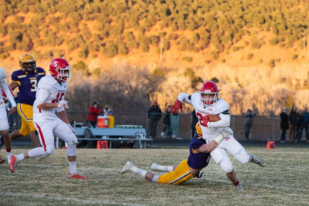 Glenwood Springs High School's Garrett Dollahan is brought down by Basalt High School's Gavin Webb during the game at Basalt on Friday, April 9, 2021. (Kelsey Brunner/The Aspen Times)