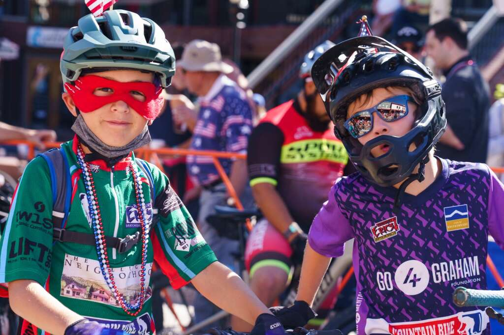 Local youth mountain bikers prepare to lead racers out onto the Firecracker 50 mountain bike course on July 4, 2021. | Photo by John Hanson