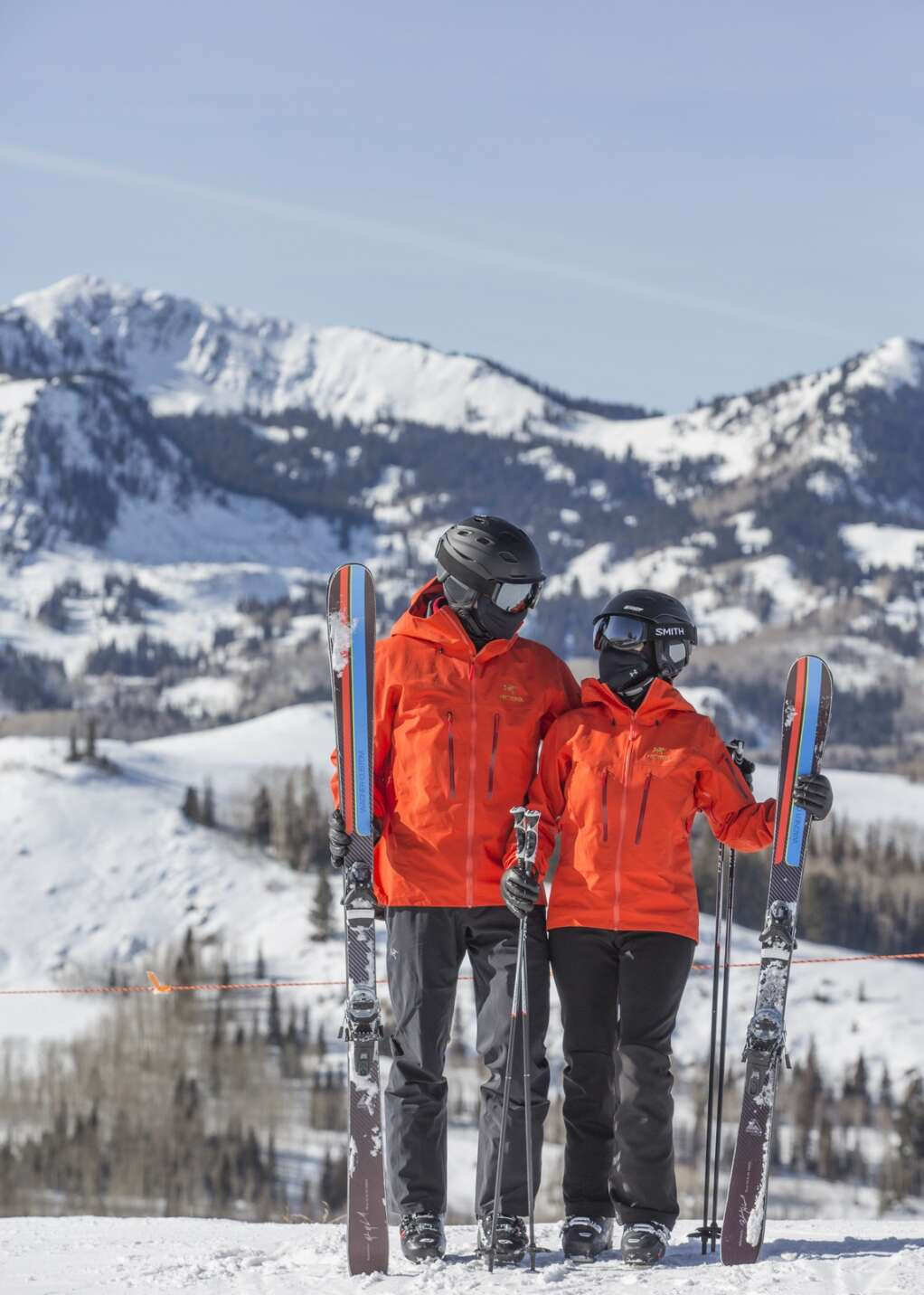 Clayton Peak is seen in the distance behind Belinda and Mike McConnell as they pose for a photo near the top of Homeward Bound, a green run at Deer Valley Resort, on Thursday, Jan. 14, 2021. | Tanzi Propst/Park Record