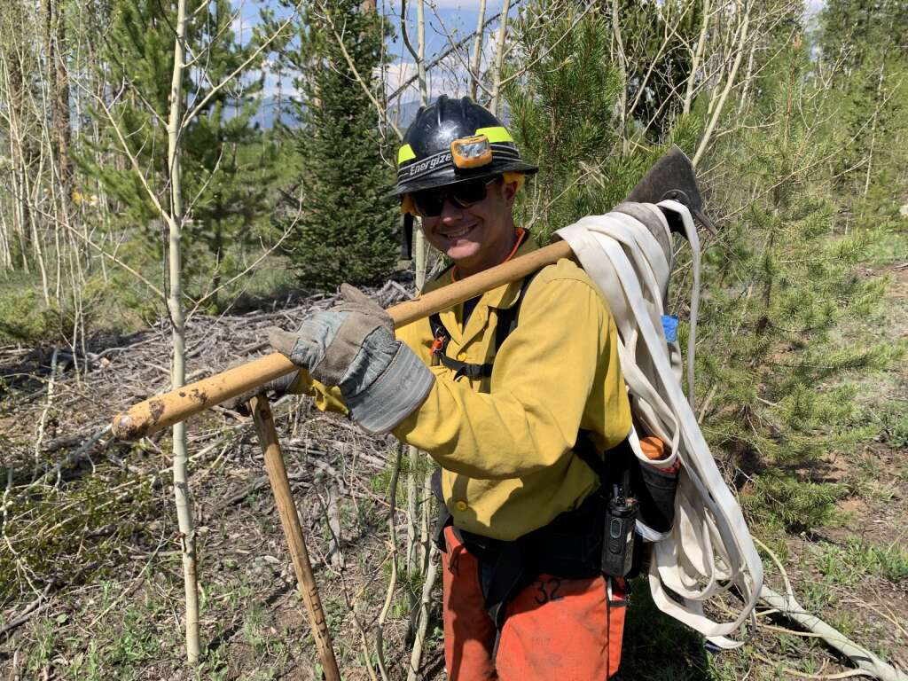 A firefighter helps to clear the scene following a wildland fire exercise Tuesday, June 8, near County Commons. | Photo by Sawyer D'Argonne / sdargonne@summitdaily.com