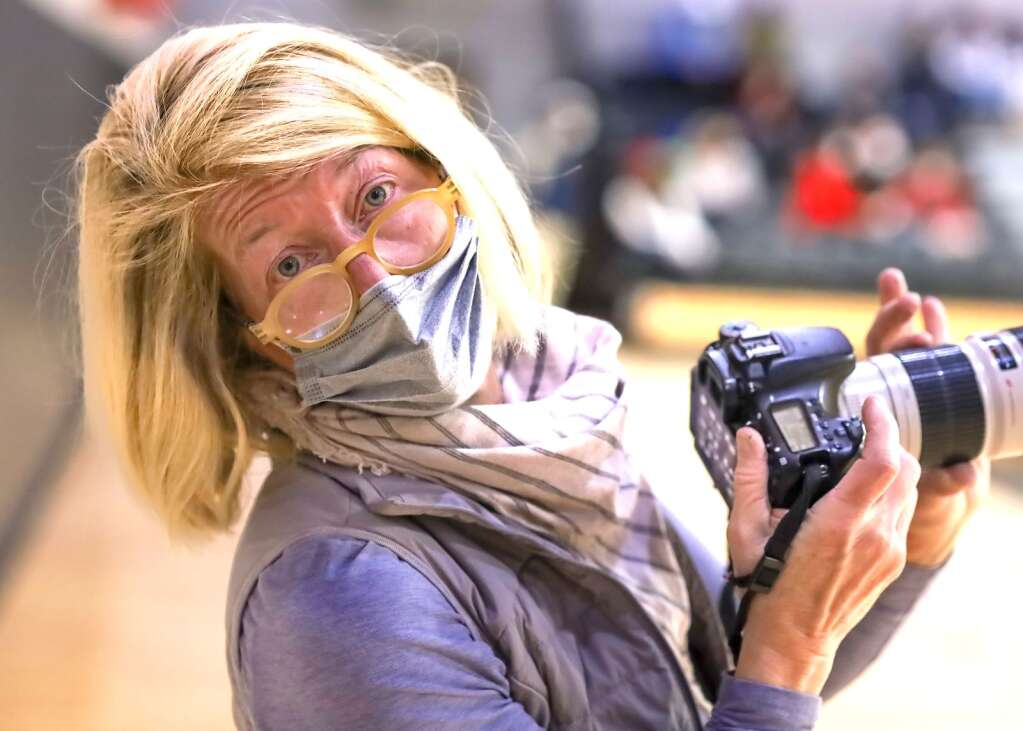 Leah Moriarty takes pictures during the Aspen High School boys basketball game against Moffat County on Saturday, March 6, 2021, inside the AHS gymnasium. Aspen won, 68-42. Photo by Austin Colbert/The Aspen Times.