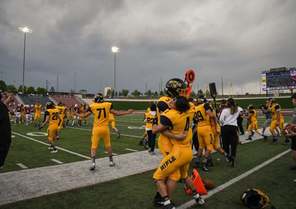 The Rifle Bears celebrate after defeating The Classical Academy 35-34 for the spring 3A state title in Pueblo on Saturday.  |Chelsea Self / Post Independent