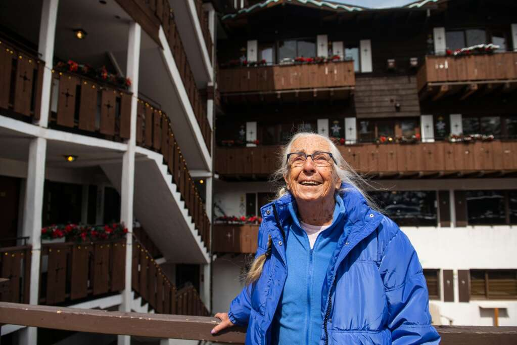 Mountain Chalet owner Marian Melville stands in the back of the lodge in Aspen on Tuesday, March 30, 2021. (Kelsey Brunner/The Aspen Times)