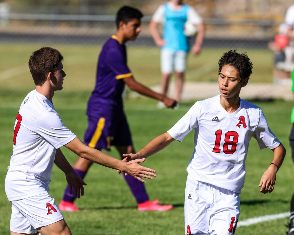 Aspen High School boys soccer player Charles Kimbrough, right, gets a high five from Will Gerardi against Basalt on Wednesday, Sept. 15, 2021, on the BHS field. | Photo by Austin Colbert/The Aspen Times