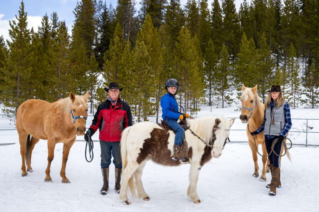 Craig Robelen, from left, Greyson Gibson and Carole Weller are pictured Thursday, Jan. 21, at the Breckenridge Equine Center on Tiger Road. Robelen and his wife, Lisa, have relocated a number of rescue and therapy horses to the unused equine center while the Blue River Horse Center looks for a new home.   Photo by Liz Copan / Studio Copan