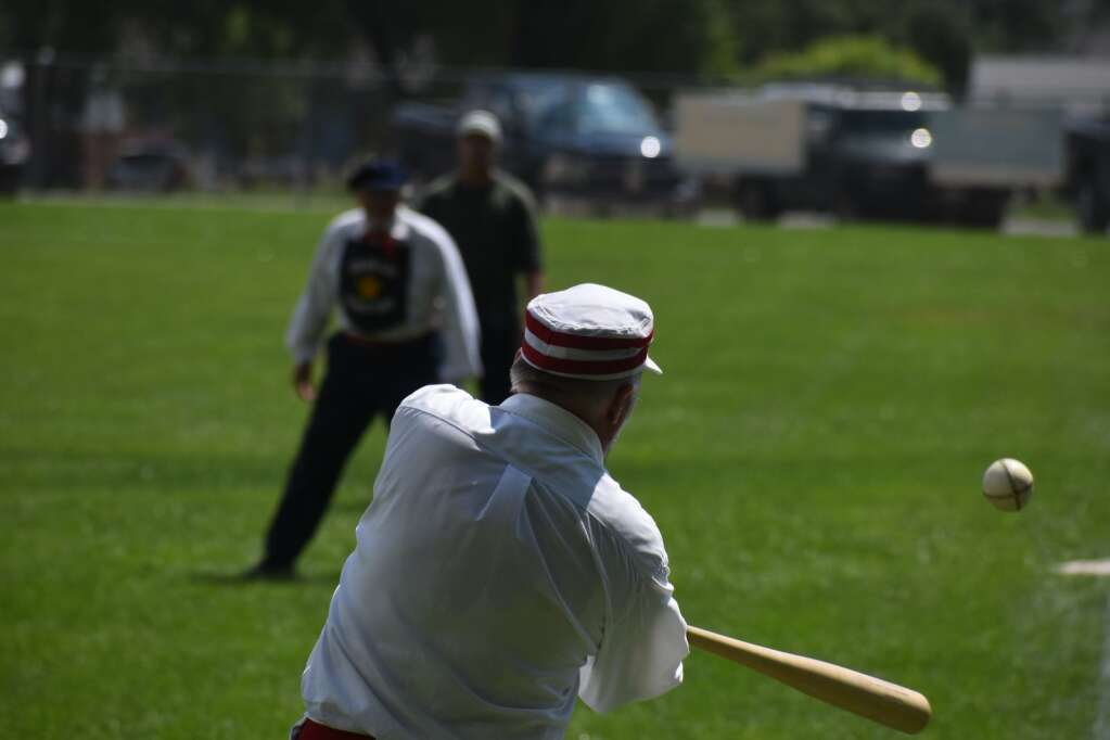 A batter makes contact with a pitch. |Ray K. Erku / Post Independent