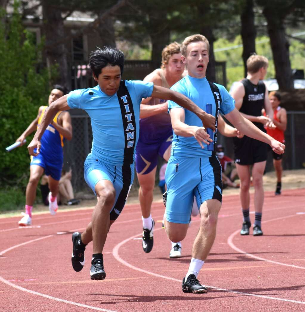 The Coal Ridge boys 4x100 relay teams makes the final hand-off en route to the win.| John Stroud/Post Independent