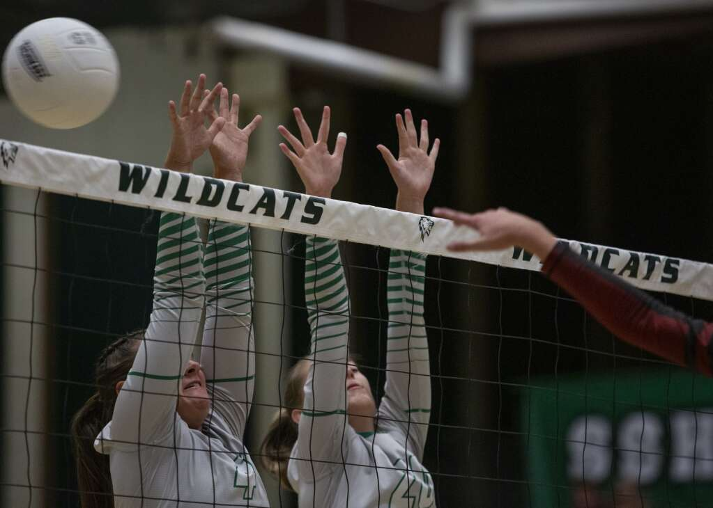 South Summit High School senior Kinley Clegg (4) and junior Addie Williams (20) jump up to the net to block a spike from Layton Christian Academy during their matchup Thursday evening, Sept. 16, 2021. The Wildcats fell to the Eagles 3-2. (Tanzi Propst/Park Record)
