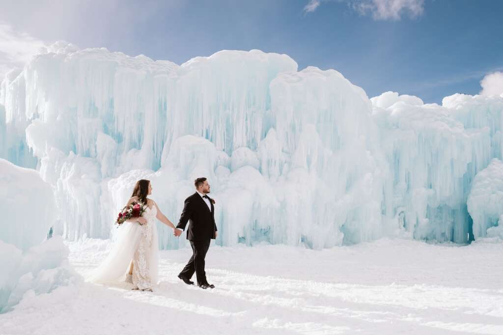 An eloping couple is photographed at Dillon Ice Castles. Summit County offers couples the unique opportunity to elope in one of Colorado's most picturesque locations. | Nina Larsen Reed/Courtesy photo