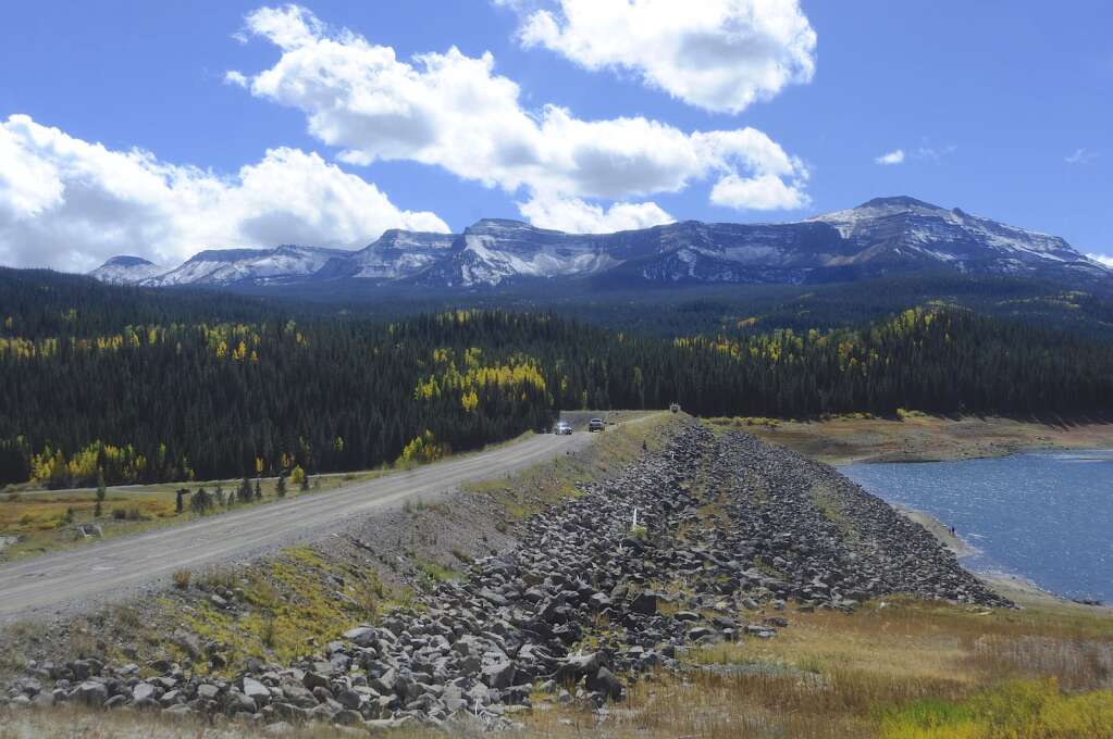 Snowcovered peaks and patches of yellow aspen show an overlap in seasons in the Flat Tops Wilderness on Monday.   Shelby Reardon/Steamboat Pilot