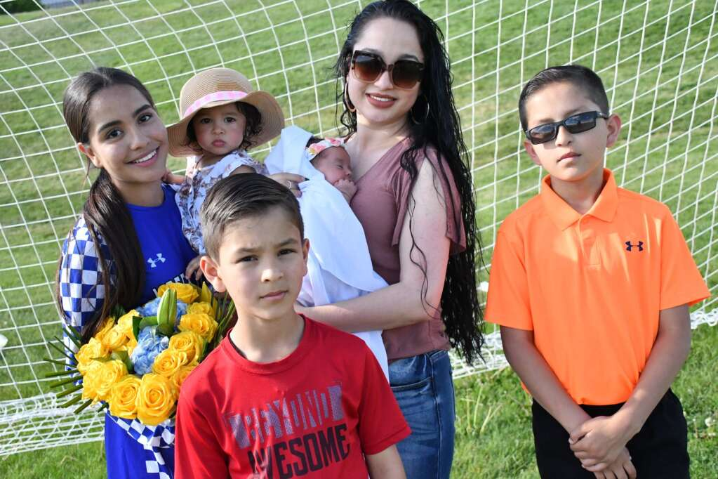 Daniella Yanez and her family pose for a photo after Moffat County girls soccer's home finale Thursday in Craig. | Andy Bockelman/For the Craig Press